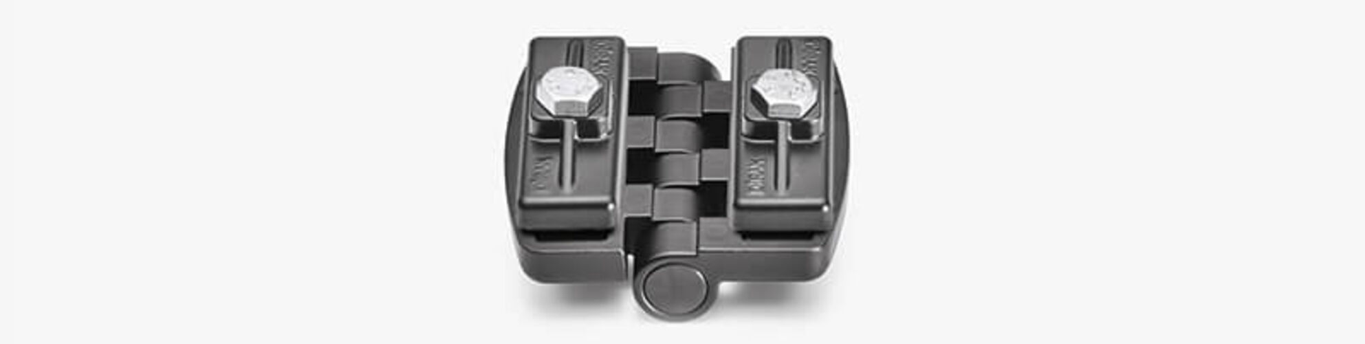 The stepped mounting surface on the back of each hinge half allows for easy alignment in the cutout and the gasketed fastening brackets can be tightened with a single screw, allowing for easy hinge positioning